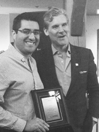 Dr. Rodrigo Navarro-Ramirez with award