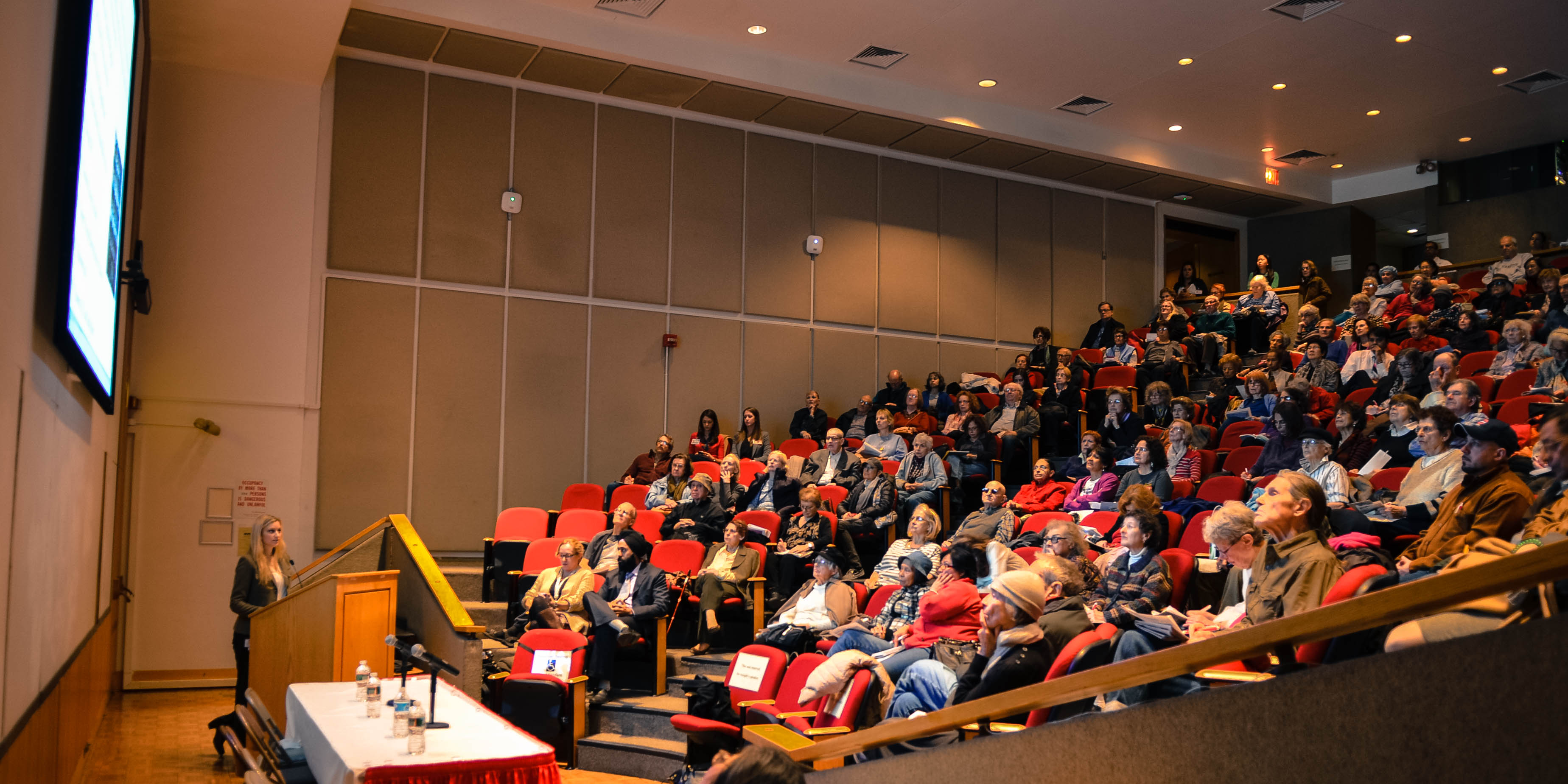 Dr. Lisa Witkin addresses a previous Health and Wellness Seminar at Weill Cornell's Uris Auditorium